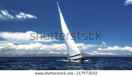 Lonely sailboat at sea. Romantic trip luxury yacht. Calm sea Sailing. Yacht  cruise. - stock photo