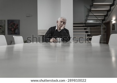 Lonely senior man being alone at big house - stock photo