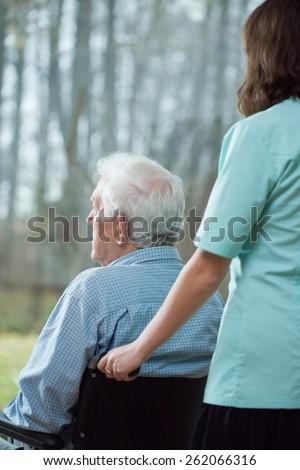 Lonely senior man staying in nursing home - stock photo