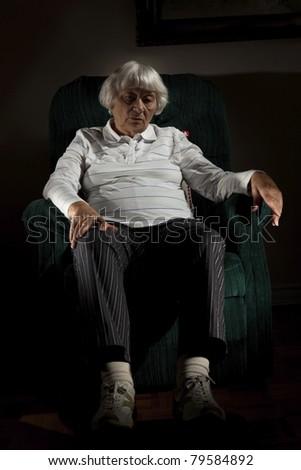 Lonely senior woman - stock photo