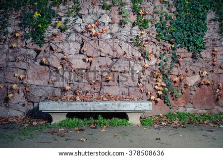 lonely stone bench - stock photo