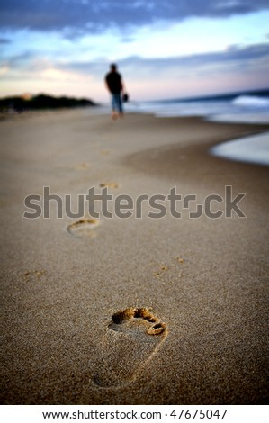 Lonely Walk on the Beach - stock photo