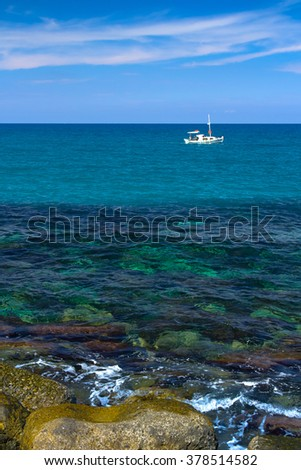 lonely white boat in the sea - stock photo