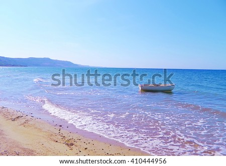 Lonely white boat on the sea                             - stock photo