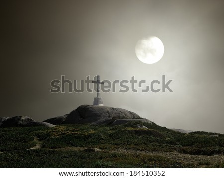 Lonely white cross in a hill - stock photo