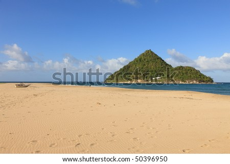 Lonely wide Beach and small island in Grenada - stock photo