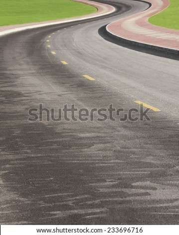 Lonely winding road in Dubai. UAE - stock photo