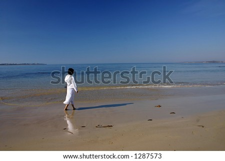 Lonely woman by the sea
