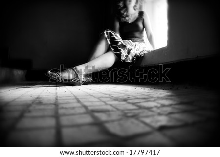 Lonely woman. Concept bw image. - stock photo