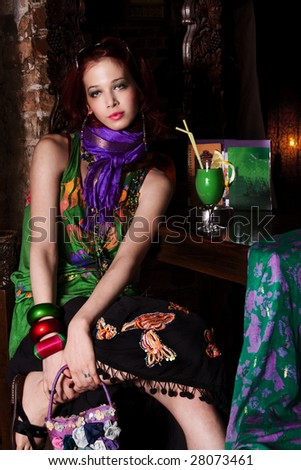 lonely woman siting in club - stock photo