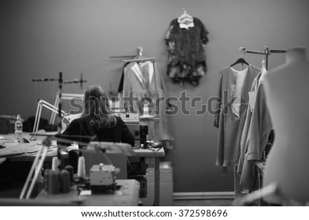 Lonely worker at atelier - stock photo