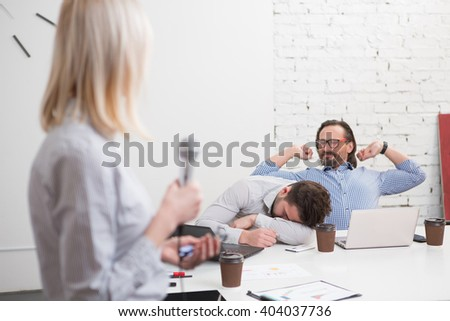 Long and boring presentation of business woman in office. Tired and exhausted men listening to her and sleeping. - stock photo