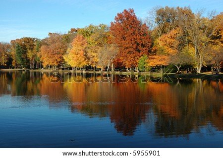 long autumn reflection in water