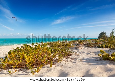 Long Bay Beach, Providenciales, Turks and Caicos, is the favorite beach for kite surfers because of strong winds - stock photo