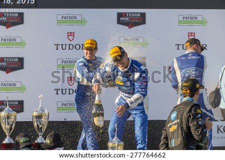 Long Beach, CA - Apr 18, 2015:  Scott Pruett and Joey Hand celebrate after a podium finish for the Tequila Patron Sports Car Racing Showcase at Long Beach Grand Prix in Long Beach, CA. - stock photo