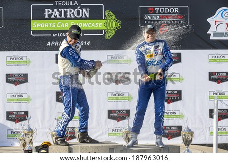 Long Beach, CA - Apr 12, 2014:  Scott Pruett and Memo Rojas, hold off the rest of the field to win the  TUDOR United SportsCar Championship of Long Beach at Grand Prix of Long Beach in Long Beach, CA. - stock photo