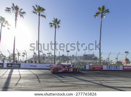 Long Beach, CA - Apr 17, 2015:  The SpeedSource Mazda Prototype,races through the turns at Toyota Grand Prix of Long Beach at Long Beach Grand Prix in Long Beach, CA. - stock photo