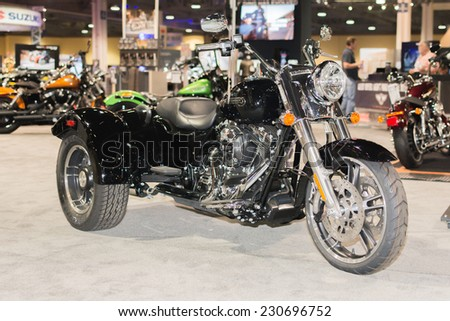 Long Beach, CA - November 13, 2014: Harley-Davidson tricycle Freewheeler 2015 on display at the International Motorcycle Show - stock photo