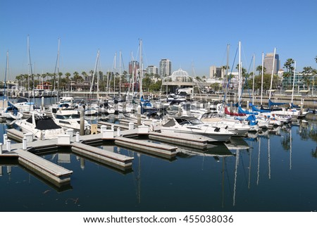 Long Beach, CA, USA - March 16, 2016: Rainbow Harbor and Marina, featuring 87 slips serving both recreational boaters and commercial operators, is home port to exciting waterfront attractions.