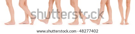 Long beautiful female legs, isolated on a white background. - stock photo