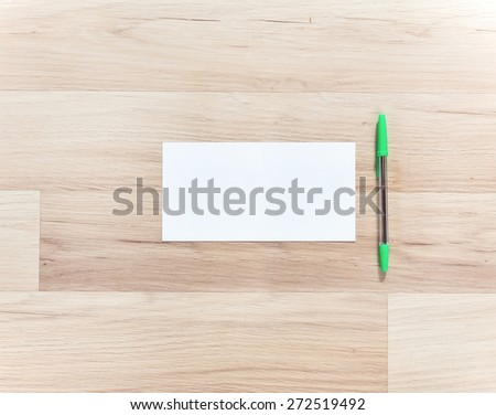 long blank paper and pen on the wooden table. View from above - stock photo