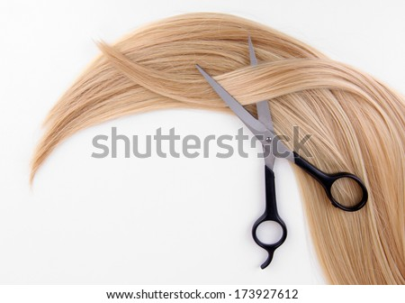 Long blond hair and scissors isolated on white - stock photo