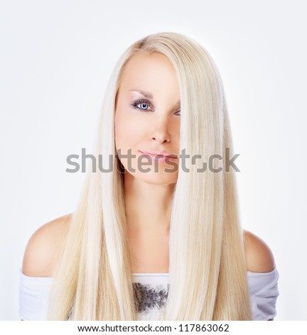 Long blonde hair beauty.Closeup, beauty high key shot of adorable young woman with long blonde hair. - stock photo