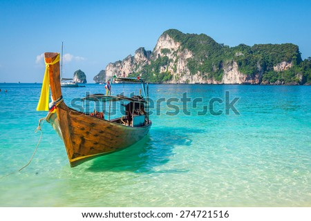 Long boat and tropical beach, Andaman Sea,Phi Phi Islands,Thailand - stock photo