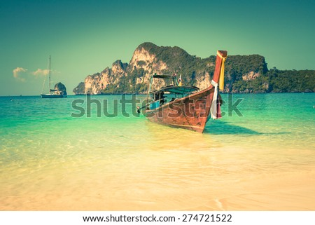 Long boat and tropical beach, Andaman Sea,Phi Phi Islands,Thailand - stock photo