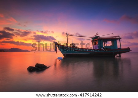 Long boat with beautiful sunrise seascape, beach in Phuket, Thailand. - stock photo