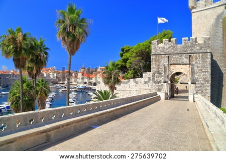 Long bridge to the sunny gate leading tourists inside old town of Dubrovnik, Croatia - stock photo