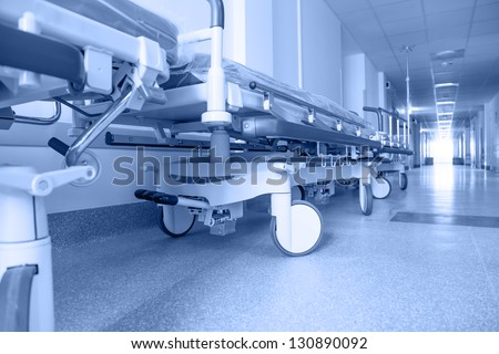 long corridor in hospital with surgical transport. tinted picture - stock photo