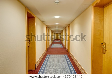 Long corridor in hotel - stock photo