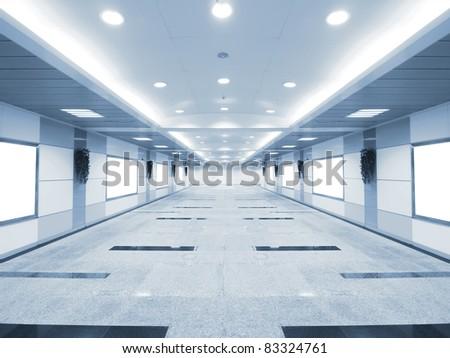 Long corridor in underground passage - stock photo