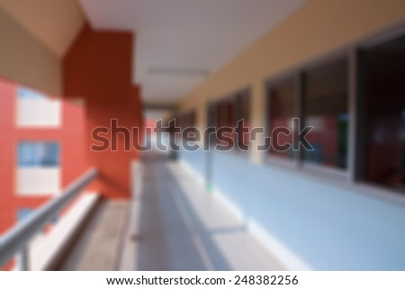 Long corridor on the sixth floor universities blurred background. - stock photo