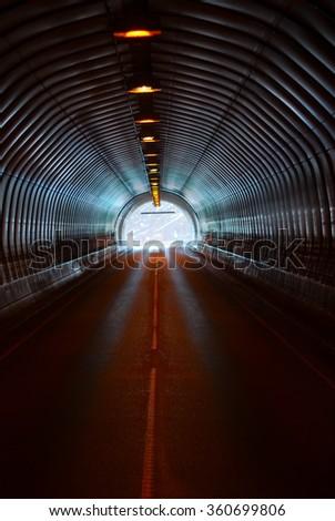 Long dark road tunnel - stock photo