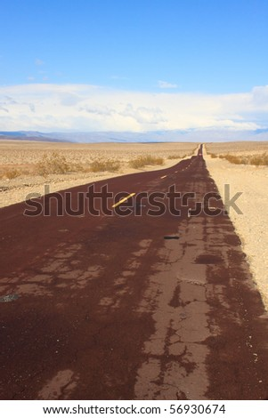 Long desert road - stock photo