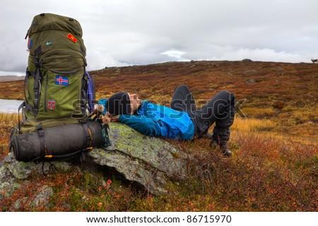 long distance Hiker takes a break - stock photo