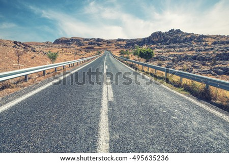 Long Empty Desert Asphalt Road