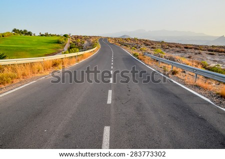 Long Empty Desert Asphalt Road in El Hierro Canary Islands Spain - stock photo