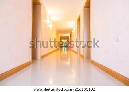 Long empty hotel hallway, corridor - stock photo