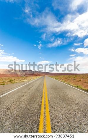Long empty road running to the far horizon - stock photo