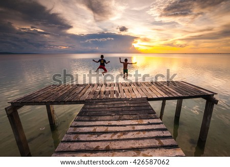 long exposed sunset seascape at a wooden jetty in Kudat Sabah Malaysia. image contain soft focus and blur. - stock photo