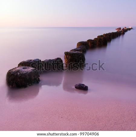 Long exposure breakwater - stock photo