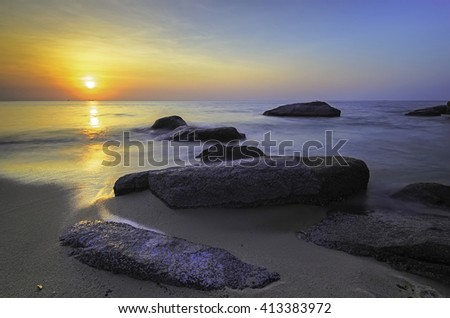 Long exposure during sunrise with dual tone color as background and boulders as the subject.