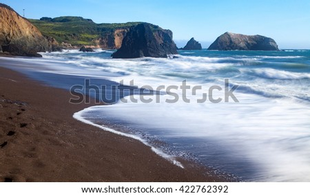 Long exposure landscape seascape of rocky coastline. California. USA - stock photo