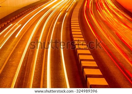 Long exposure  night Traffic of Road Tunnel. Closeup. - stock photo