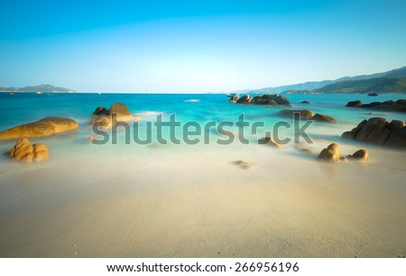 long exposure of beach in island, white sand and rock  - stock photo