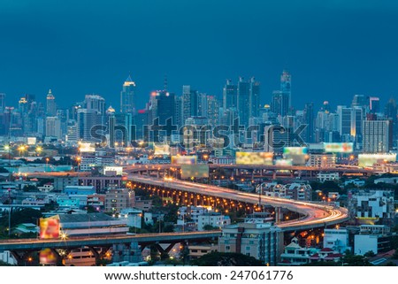 Long exposure of Expressway through Central Business Center, during twilight - stock photo