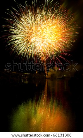 Long Exposure of Fireworks Against a Black Sky - stock photo